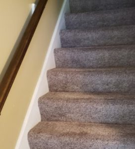 Picture of stairway carpet after cleaning.