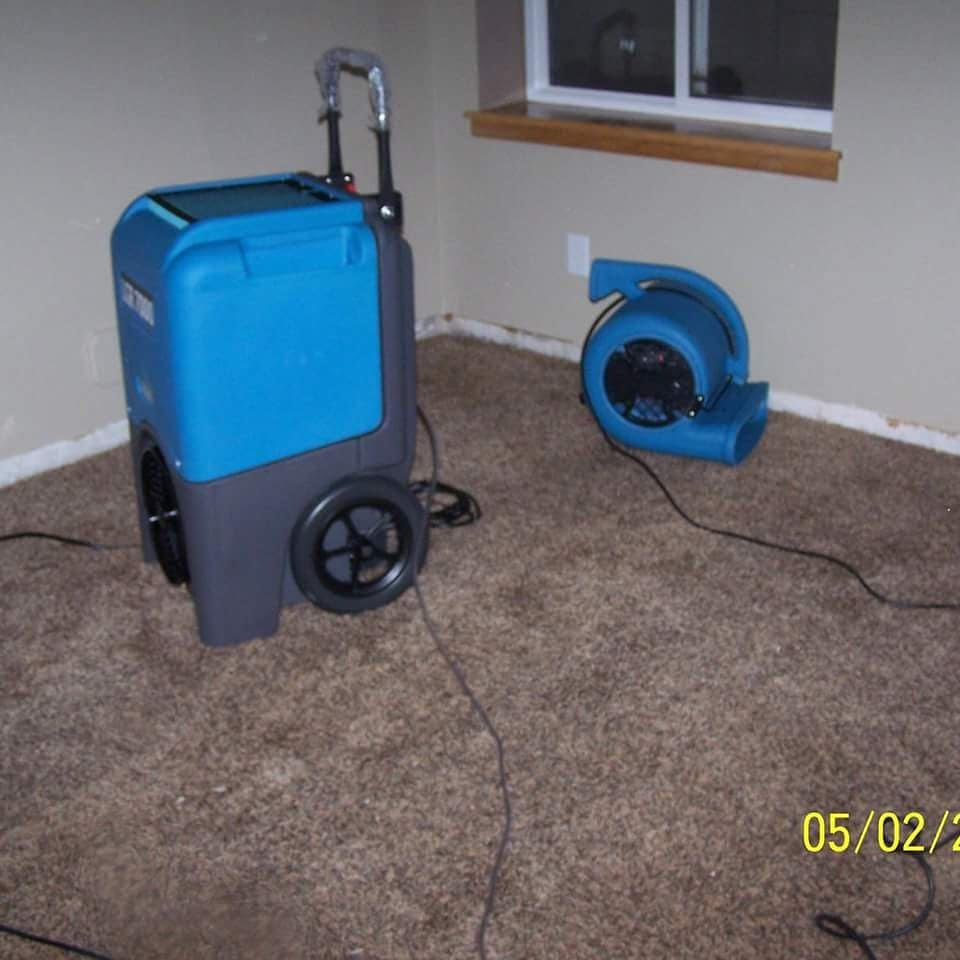 Picture of carpet drying process.  Many times multiple dryers are required to minimize the drying time